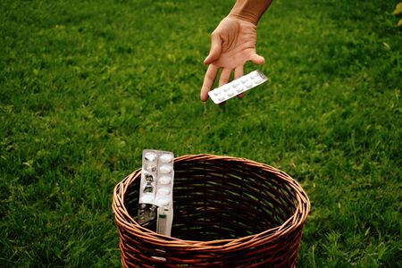 Throwing packs of drugs in the trash. Recovery and alternative medicine. Stok Fotoğraf