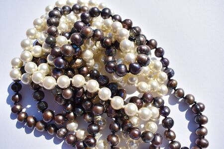 Glamorous background with antique tinted. Natural sea pearls.