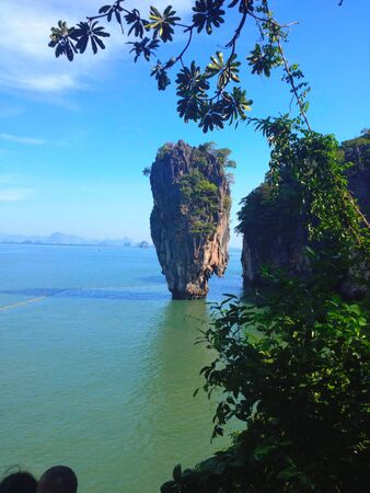 Mountain Bottle Island in Thailand. Picturesque high mountains in the sea.