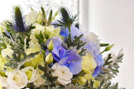 Wedding flowers for the bride. Blue-white bouquet of flowers with hydrangea.