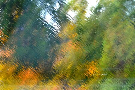 Blurred car windshield. Rain is pouring on the glass Stock Photo