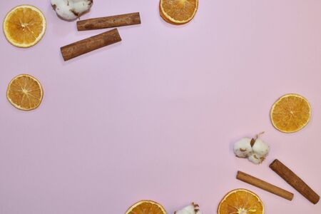 Pink wallpaper with decorative floral elements. Slices of dry orange, cinnamon on pink Stok Fotoğraf