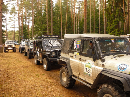 Trapped jeeps in mud and slush. Male dangerous racing hobby.