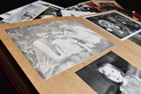 Old paper retro photo album with family photos. Antique vintage album for photo cards.