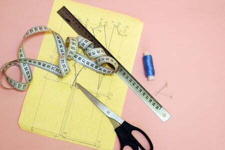 The concept of cutting and sewing. Female needlework. Atelier and clothing modeling.