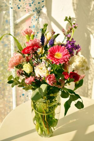 Flower arrangement in the interior. Morning with flowers. Flowers for mothers day and womens day. Spring flowers for beloved