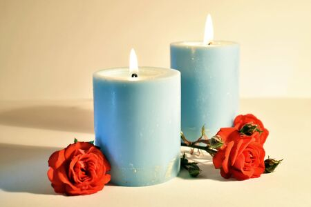 Burning candlelight and flower buds on the table. Romance meditation design. Memorial Day.
