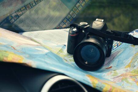 Photohunting on vacation. Camera and world map - traveler things