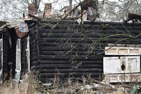 Arson at home. Burnt walls of the house.