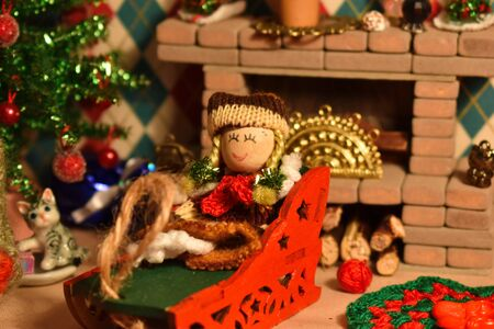 New Year's interior in miniature toy room. Cozy room for little toy doll. Handmade miniature winter accessories.