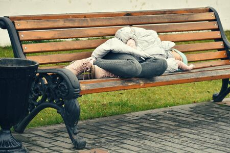 Problem of refugee children. Child left home and sleeps on the street. Abandoned child.