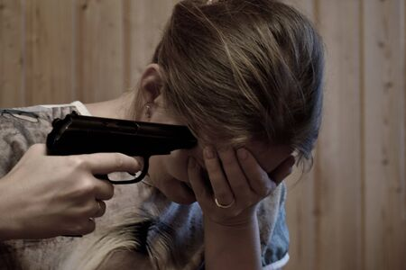 A woman wants to end  life. On the verge of suicide. Shoot a gun in the head.