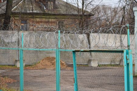 Prison Fence with Wound Barbed Wire.