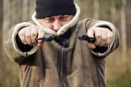 Dashing 90s.  Crime and aggression. Hitman. Russian Mafia. Street shootout.