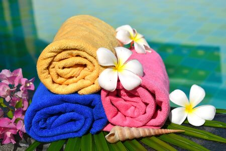 Body care is health. Relax in the swimming pool. Tropical vacation.