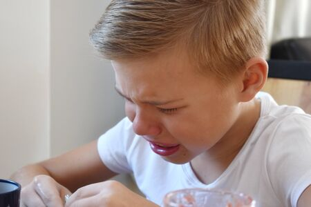 suffering child in the room. Children's insults and tears.