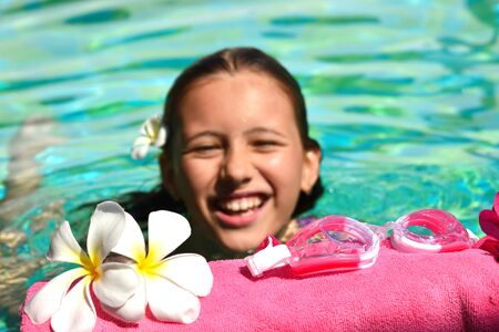 Cute baby girl in the water. Relaxing water treatments. Vacation and travel concept at sea. Pool at the hotel.