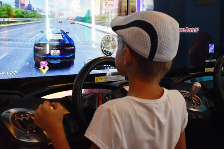 Thailand. Hua hin. January 2020. A boy plays computer games at the Mall. simulator machine games. Car racing game with the wheel.