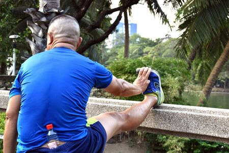 Thailand. Bangkok. January 2020. The athlete in a public Park. A man goes in for sports in Central Park. Health care.