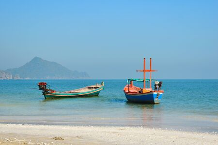 Wooden traditional ships on the ocean. beautiful sea landscape. A tropical vacation. The trip to Asia.