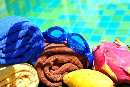 Swimming goggles on a towel by the pool. Luxury quiet holiday in the seaside resort. beautiful pool in the hotel. Reklamní fotografie