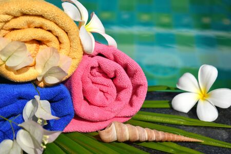 Swimming pool with flowers. Spa vacation at the resort. tropical sea hotel with a swimming pool. water wellness therapy.