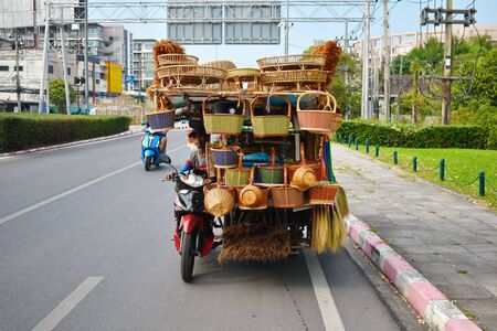 Asian cars. The driver carries the car a lot of goods. Loaded machine. Trade in Asia.