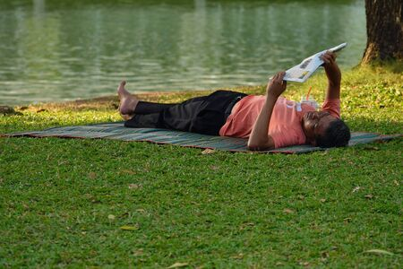 Photos of ordinary people in a Park in Bangkok. Asian passers-by. Redakční