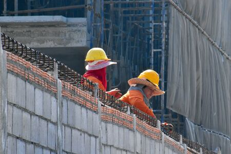 normal construction work in Asia. Worker construction process autdoor Redactioneel
