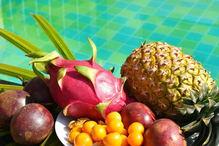 Tropical exotic fruits at the resort. Exotic food in the pool area. coconut in the tropics. Vitamin Breakfast on vacation Reklamní fotografie