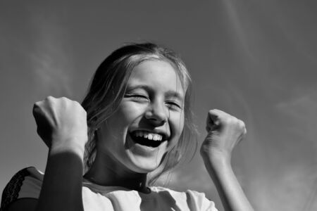 Monochrome photo. Close up of the face of the smiling girl