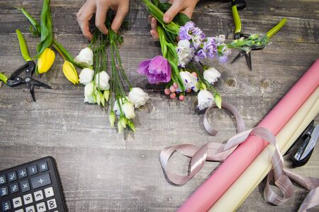 Floral bouquets on the table. Floral background. Tools of the florist.
