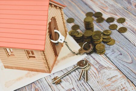 The debt on the loan. The mortgage interest. Expensive housing. Sale for debts Stock Photo