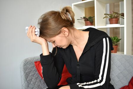 A woman who suffers chronic migraines. pills for pain