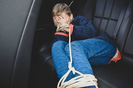 the captive child in the car. Illegal theft and ransom of a child