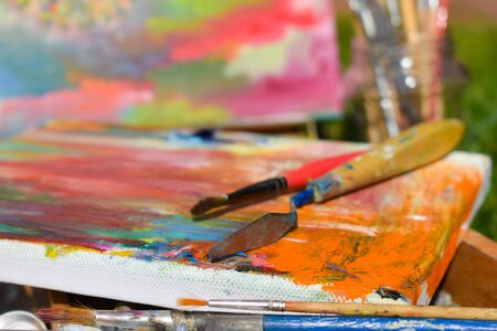 The artist paints a picture in oil. The picture is picturesque. art therapy