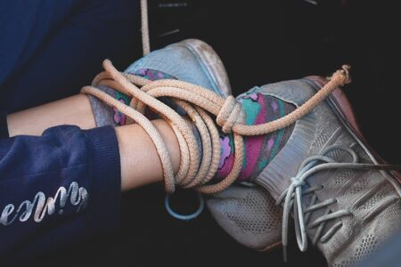 ropes on the hands of little victim girl. Violence against children. Kidnapping