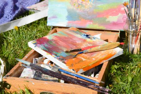 Oil painting on canvas in the park. Drawing outdoor.