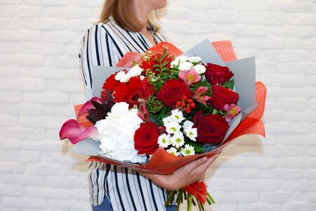 woman holds in hands beautiful bouquet of flowers. Women's Day, Valentine's Day Archivio Fotografico