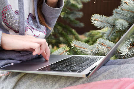 education on the Internet. Teenager with laptop on grass. Girl freelancer Archivio Fotografico