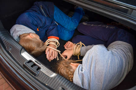crimes with children. Victims of children in trunk of car. Illegal imprisonment