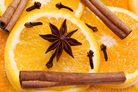 mulled wine spice: Christmas spices for mulled wine. Orange, cinnamon, cloves, star anise. Close up
