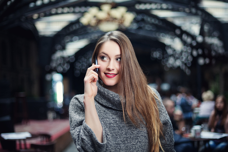 looking aside: Young beautiful happy smiling woman speakig on mobile phone and looking aside. Stock Photo
