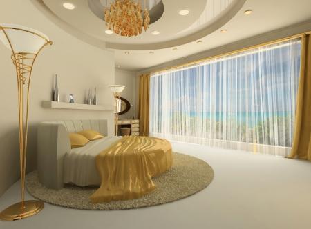 Il letto rotondo in un lussuoso interno con una grande finestra. Costruzione del soffitto rotondo con la parete semicircolare. Albergo. Appartamento moderno. Golden decorativi