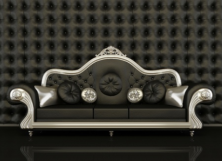 private club: Classic leather sofa with a silver frame on black background. Button background of black wall. Comfy couch and decorative pillow
