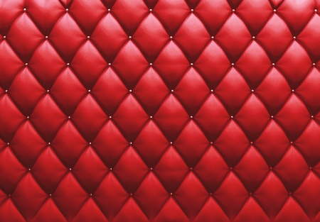 Buttoned on the red Texture. Repeat pattern  Stock Photo