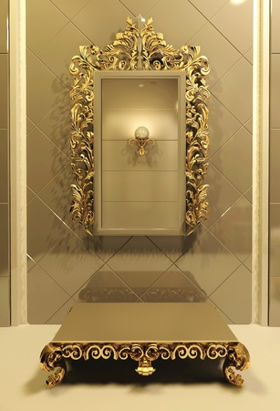 Royal mirror with gold frame in luxury interior photo
