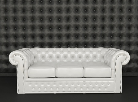 White leather sofa on a black background  Stock Photo - 10300749