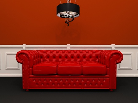 Red leather sofa with chandelier in original interior photo