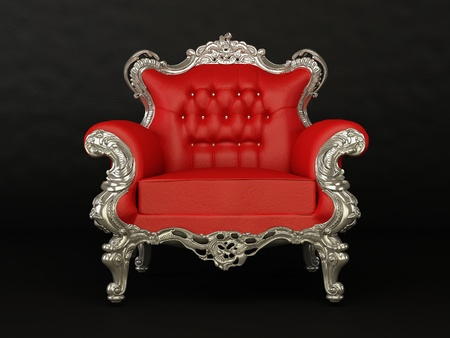 Luxurious red armchair on the black background photo